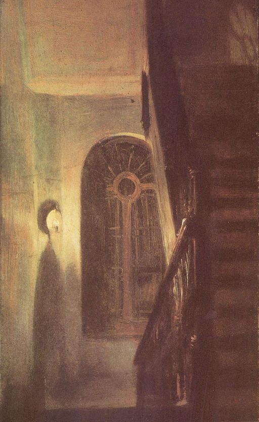 Dimly lighted hallway with spooky stairway to the right