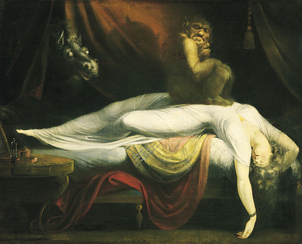 Woman on bed with demon sitting on her chest